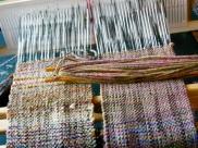 Valeri is weaving a bag.